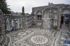 """Isidore built his house, courtyard, chapel and tomb out of concrete and encrusted them with dense mosaics made of pottery shards and other found objects. His designs have personal, religious and regional significance. The site is now classified as an historic monument and known as """"Picassiette,"""" the townspeople's nickname for Isidore."""