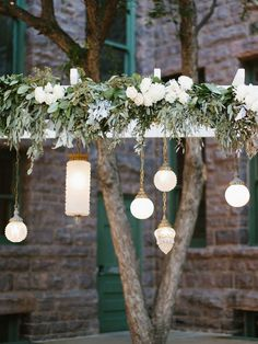 Vintage glass lamps will offer a soft glow during your outdoor ceremony. Hang them from a homemade arbor and decorate with delicate blooms and lots of greenery.
