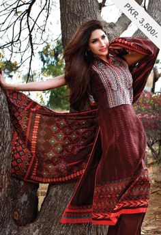 AKL - 2108 Balochi - Brown  - 2.5 meter shirt with extra sleeves  - Embroiderd Neck on shirt  - Lawn Dupatta  - Dyed Shalwar