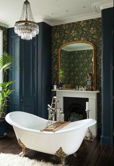 Vintage styled bathroom with claw foot bath.