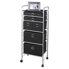 "Six-drawer metal storage cart.  Product: Storage cartConstruction Material: Polypropylene and steelColor: Black and silverFeatures: Five different sized drawersDimensions: 42.75"" H x 16.3"" W x 13.6"" D"