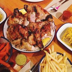 """ALL THE CHICKEN at COOP Chicken House.  you're still hungry after that, get the crumble. They serve it to you by bringing out the tray and spooning it into your bowl until you say """"stop""""."""