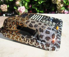 Hey, I found this really awesome Etsy listing at http://www.etsy.com/listing/117470563/leopard-print-swarovski-crystal-desk