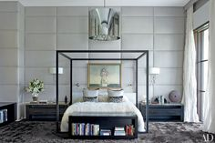 The walls of this Florida master bedroom decorated by Furze Bard + Assoc. are upholstered in an Élitis linen.