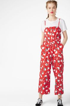1f8aaabb9c3 A button up jumpsuit with adjustable spaghetti straps