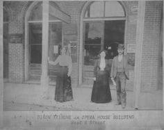 Dixon Tribune office in the Opera House Building on West B Street. 1890 circa ? The building is built of brick, so it was built after the 1883 fire that destroyed that block of businesses. Two ladies in long, dark skirts, white blouses. One male in suit and derby hat.