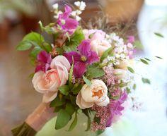 Pretty Wedding Bouquet With Peach Tulips, Peach Garden Roses, Fuchsia Clematis, Pink Riceflower, White Waxflower, Green Foliage