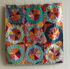 Blue Elephant Stitches: Spinning Stars Quilt - love the color palette.