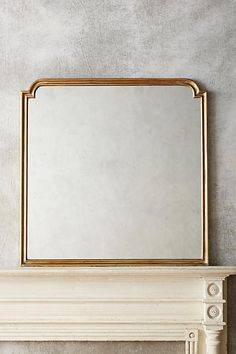 "Anthropologie - Aperture Mirror in Gold. 40.25""H x 40""W.    $368 retail"