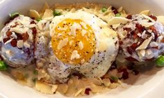 Chicken Carbonara Balls with sweat pea and caramelized onion ravioli,with roasted garlic cream and fried egg