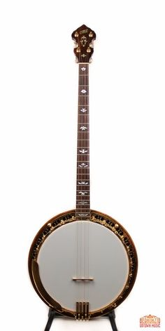 """Extremely clean, high quality Monarch model featuring 26-1/4"""" highly figured curly mahogany neck, rim, and resonator. Gold-plated metal hardware, rosewood fingerboard w/ pearl inlay; gold-plated flat-head tonering. Sweet, balanced tone. Includes original hard-case. In fantastic condition, little to no wear present."""