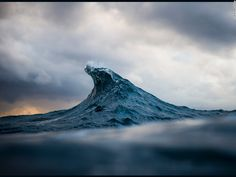 """<a href=""""http://raycollinsphoto.com/"""" target=""""_blank"""">Ray Collins</a>' awe-inspiring images have the power to bring the earth's primal force to a standstill. Here, the 32-year-old Australian captures a split second in the sea to reveal the wave's twisted topography, and the momentary splashes of light across the surface."""