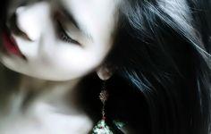 black hair, pale skin
