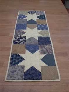 Quilt Blue and gold star table runner hand quilted. $25.00, via Etsy.