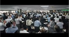 Wolf of Wall Street by Martin Scorsese. My favorite scenes from this movie are the office scenes with hundreds of workers dressed in white, black, grey and blue. A long focus shows how huge the room is.