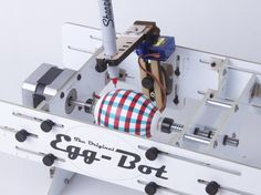 The Original Egg-Bot! The Eggbot is an open-source art robot that can draw on spherical or egg-shaped objects from the size of a ping pong ball to that of a small grapefruit– roughly 1.25 to 4.25 inches in diameter (3 – 10 cm).