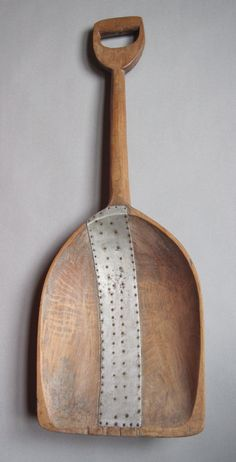 Primitive wooden shovel, c.1870 with make-do repair                         ****