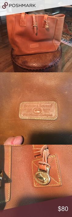 Dooney and Bourke travel tote Classic leather carry all that is perfect for school or work. There leather is in great condition with some wear, see pics, but it just looks more vintage/classic so it does not hinder the style. This is a large size, so it would also be a great traveler. Dooney & Bourke Bags Travel Bags