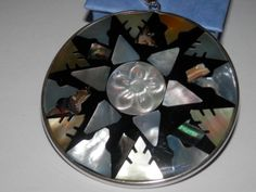 A great pendant to wear on an omega necklace, this pendant will look great with all your fall clothes! It is a large pendant measuring 2 inches. Has black onyx backing and is set in 92.5 high polish sterling silver. Spectacular design and lovely iridescence.