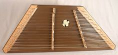 """This James Jones Custom 16/15 with 1"""" string spacing has a Cherry frame with Lacewood pin panels, a Redwood soundboard made tan with Wenge trim. Bridges are Cherry"""