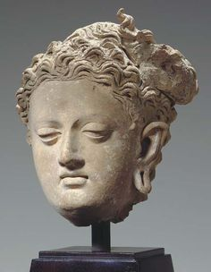 A Terracotta Head of Maitreya GANDHARA, 3RD/4TH CENTURY