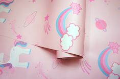 This glittery cute unicorn wallpaper features unicorns, rockets, rainbows, planets, stars and clouds. Size: x Roll) and Pink in colour. Childrens Bedroom Wallpaper, Wallpaper Design For Bedroom, Baby Nursery Wallpaper, Kids Wallpaper, Perfect Wallpaper, Dark Wallpaper, Peel And Stick Wallpaper, Designer Wallpaper, Kids Bedroom