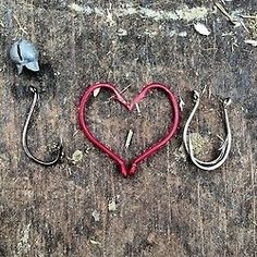 I love you craft made out of fish hooks