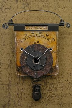 found object Brooch - Carolyn Bond-- miliamp meter part, camera parts, old washer, nut, mica, polymer clay, wire