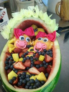 Twins in watermelon basket . Baby shower from Donna's old town cafe,llc Fruit Basket Watermelon, Watermelon Boat, Watermelon Carving, Baby Shower Fruit, Baby Shower Cakes, Baby Shower Gifts, Fruit Arrangements, Fruit Recipes, Creative Food