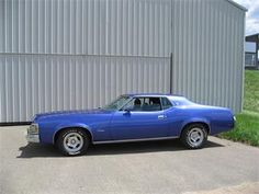 1973 Mercury Cougar.  Mine was white with a brown vinyl top.
