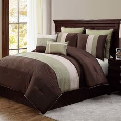 Features:  -Set includes: One comforter, two euro shams, two shams,one bedskirt, one breakfast pillow, one square pillow.  -Machine washable.  -100% Polyester.  Product Type: -Comforter/Comforter set.