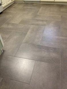 Mudroom flooring. Gray, wood grain tile in herringbone pattern. {a ...