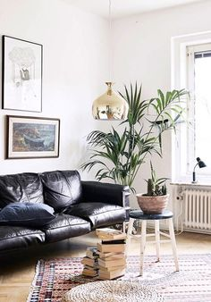 black leather sofa in modern apartment / sfgirlbybay