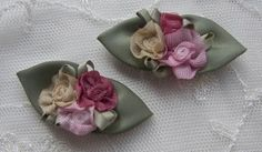 Thank you for stopping by my store today.    Up for your consideration is a lot for 12 pieces of HANDMADE Ribbon FLOWER clusters. Three ribbon flowers with satin green ribbon leaves in colors of pink, gold and wine are clustered together in the center of two large satin leaves. All three colors of the flowers compliment each other very nicely.    They can be used to EMBELLISH Lamp Shades, Hand Towels, Pillows, Clothing, Hats, Quilts, Dollmaking and all your Sewing, Home Decor or Craft…