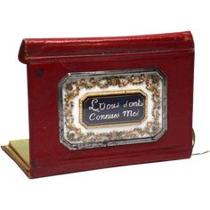 RARE Antique Eighteenth Century Red Morocco Secret Message Carnet with Opaline Medallion. This precious carnet has a secret message medallion set under glass. This type of work was popular during the period and was purchased to be given to a special loved one.