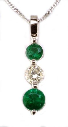 Diamond and emerald pendant with 0.50ct tdw and 5.75mm and 4.75mm round emeralds in 14k white gold