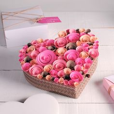 Don't know what to do with your old heart-shaped box? Take out craft papers (colors of your choice) then cut out strips of different widths. Then roll these papers and glue them together.