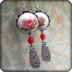 Trinket: coral rose limoge and russian nesting doll silver charm earrings