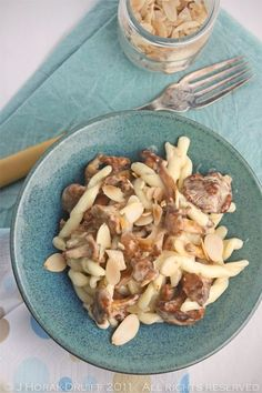 An indulgent recipe for pasta with creamy chanterelles and toasted almonds - make the most of these fabulous mushrooms while the season lasts!