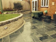 Marshalls' Slate paving with Sandstone walling