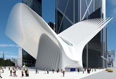 The World Trade Center Transportation Hub in Lower Manhattan. The hub replaces the PATH train station that was destroyed during the 9/11 terrorist attacks.  Designed by Spanish architect Santiago Calatrava, the Transportation Hub is composed of a train station with a large and open mezzanine under the National September 11 Memorial plaza. This mezzanine is connected to an above ground head house structure, called the Oculus,