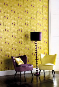 Bold colours such as Yellow and Purple are contrast colour each other. However, these show more impact and impressed images. Bold wallpaper colours and bright chairs bring life to this space.