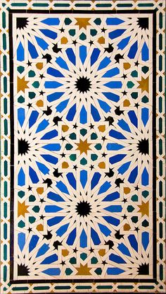 Islamic tile design. Spain.  I like how eight stars in the center make a square.