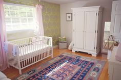 Beautiful nursery with a vintage French look photographed by Tara Tomlinson Photography