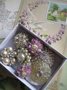 Vintage brooches or earring make a great detail with ribbon around centerpiece vases or placesettings. Start collecting!