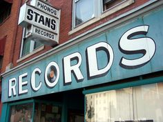 Learn all about the history of Record Store Day and why it's one of the biggest days of the year for music and vinyl fans alike! Vinyl Record Shop, Vinyl Store, Vynil Records, Empire Records, Music Signs, Vinyl Junkies, Record Players, Store Signs, Vintage Signs
