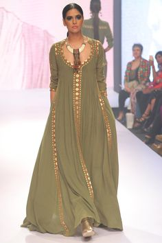 Olive pleated maxi dress Featuring an olive pleated maxi dress tailored in cotton accented with contrast detailing. Fabric: Cotton Source by shivanikardham fashion indian Pakistani Fashion Party Wear, Pakistani Dress Design, Pakistani Dresses, Indian Fashion, Kaftan Designs, Kalamkari Dresses, Dress Indian Style, Indian Designer Suits, Dresser