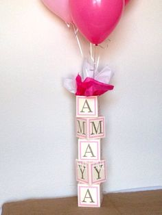 Make a statement with these alphabet blocks! These alphabet blocks are designed to stack on top of another and have a string of balloons run through them. ****THESE BLOCKS ARE 4.5 INCHES TALL EACH! THEY ARE MADE TO SIT ON A TABLE. *** Each block is 4.5 inches tall, wide, and