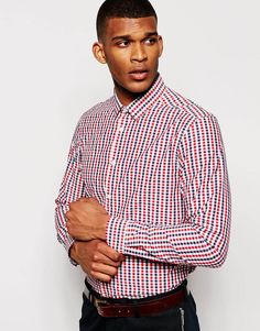 """Smart shirt by ASOS Soft-touch, woven fabric Spread collar Button placket Regular fit - true to size Machine wash 55% Cotton, 45% Polyester Our model wears a size Medium and is 188cm/6'2"""" tall"""