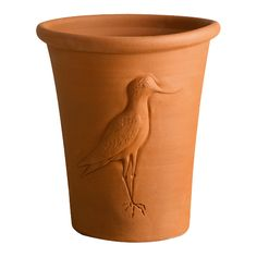 Avocet Pots - This pot is one of our new designs for 2012 and is the ever popular long tom decorated with the Avocet bird. The proportions of the pot were perfectly suited to Jim's Avocet mould! The mould is offered up to the outside of the pot then the wall of the pot is pressed out by hand into the mould from the inside.